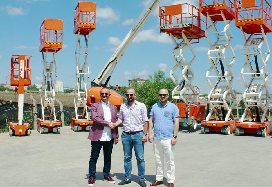 L-R: Yusuf Tursun, president of Uzman Lift, Kenan Aydin, MD of Fatih Vin, and Mehmet Karakaya, GM at Uzman Lift, with some of the Snorkel scissor lifts delivered to Fatih Vin.