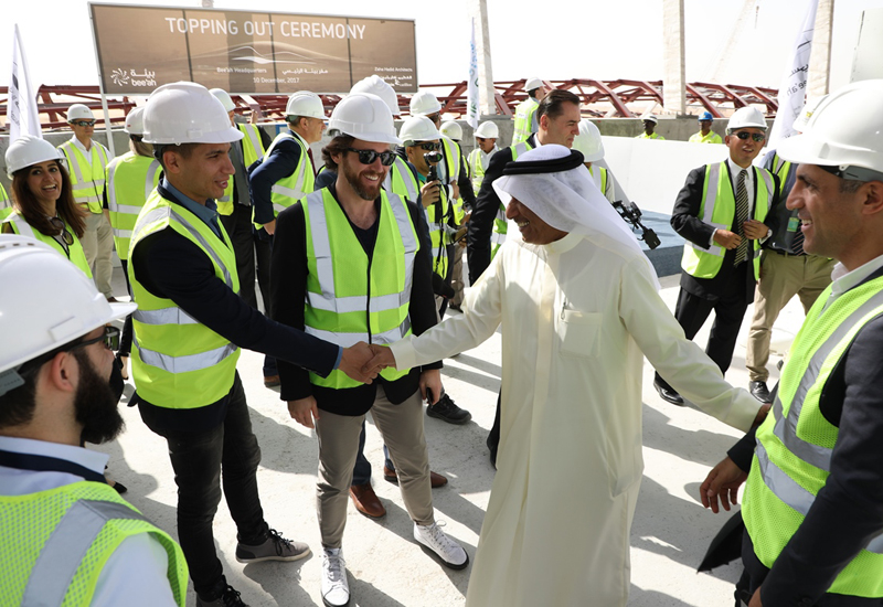 Officials from Al Futtaim Carillion, Bee'ah and Zaha Hadid Architects at the topping out ceremony.