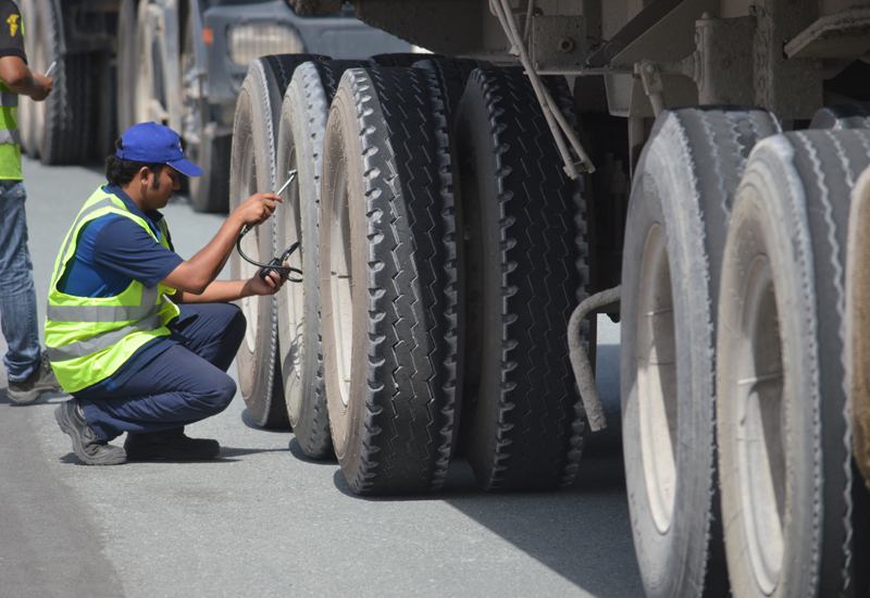 A technician checks a truck's tyres in the campaign.