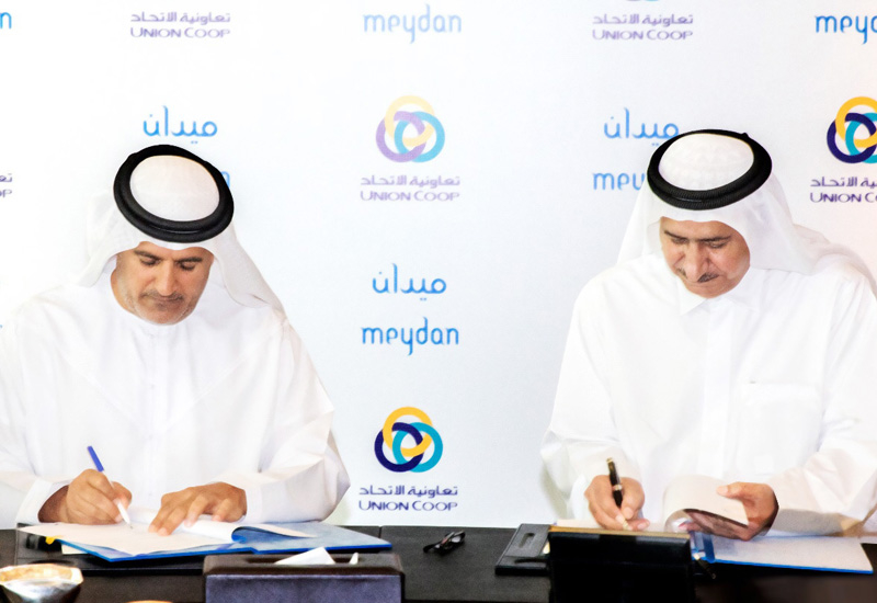 Al Shamsi and Saeed Humaid Al Tayer during the signing of the contract.