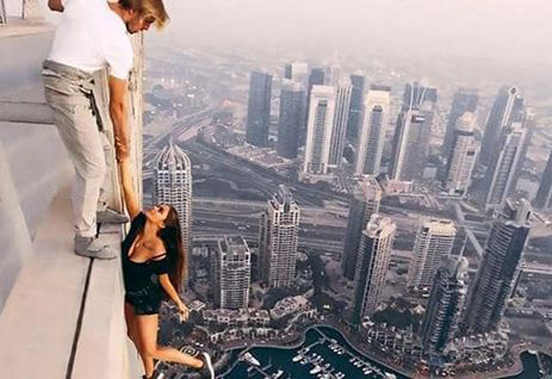 Cayan Group has condemned Viki Odintcova's decision to hang off the side of Dubai's Cayan Tower without taking any safety precautions.