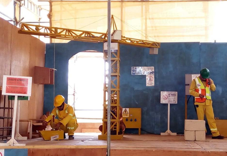 The facility at ANGE's training centre includes the use of props fabricated by the team, including a wooden telehandler and tower crane.