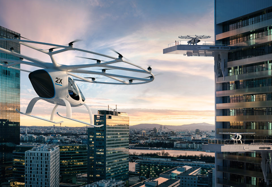 A conceptual visualisation of the E-Volo 2X as a mode of transport in a high-rise urban environment.