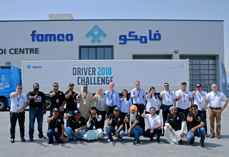 Pakistani national Younis Khan (bottom row, third from left) was named Volvo's best truck driver in the UAE at an event hosted by FAMCO.