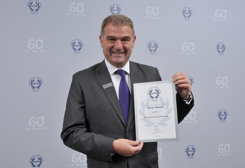 Wayne Taylor (above), group head of HSE at S&T Interiors and Contracting, collected the firm's silver award at the 60th RoSPA Occupational Health and Safety Awards.