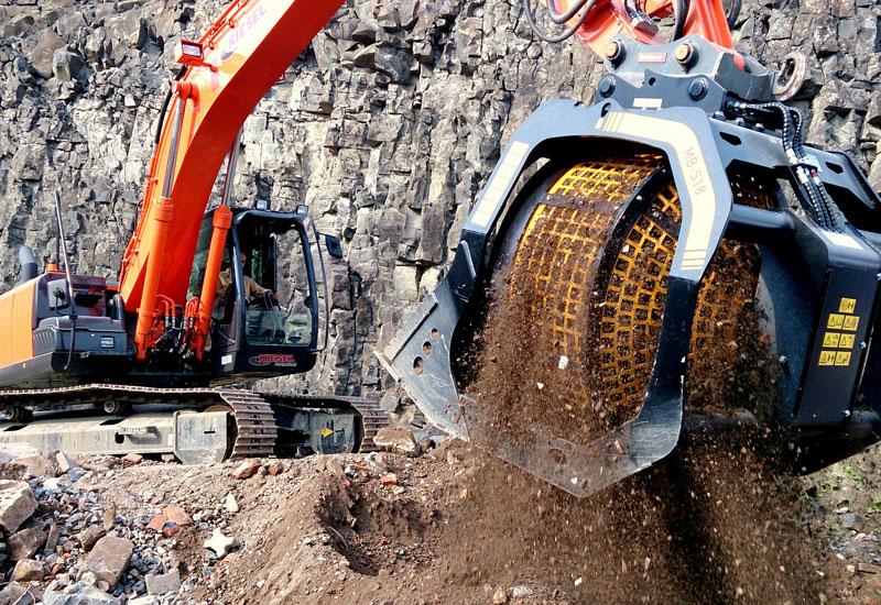 A bucket screener from Italy's MB Crusher sorts loose aggregates through its rotating drum equipped with a mesh size optimised for the task at hand.