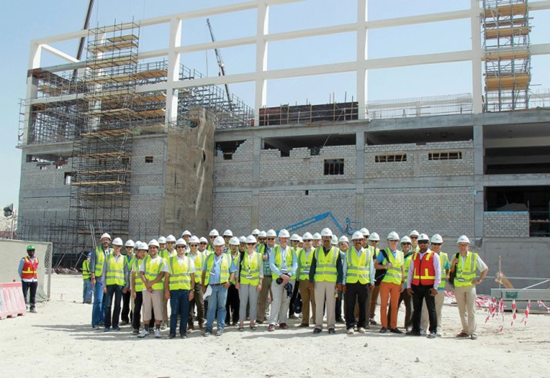 International Engineering Insurance Association delegates posing for a group picture at the construction site of the Khalifa International Stadium. (Image:<i>The Peninsula</i>).