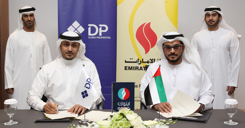 Officials from Dubai Properties and ENOC Group at the deal signing ceremony.