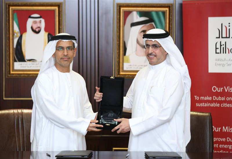HE Saeed Mohammed Al Tayer, chairman of Etihad ESCO, and HE Abdulrahman Al Saleh, chairman of Dry Docks World, signed a service agreement. [Image courtesy: Dubai Media Office]