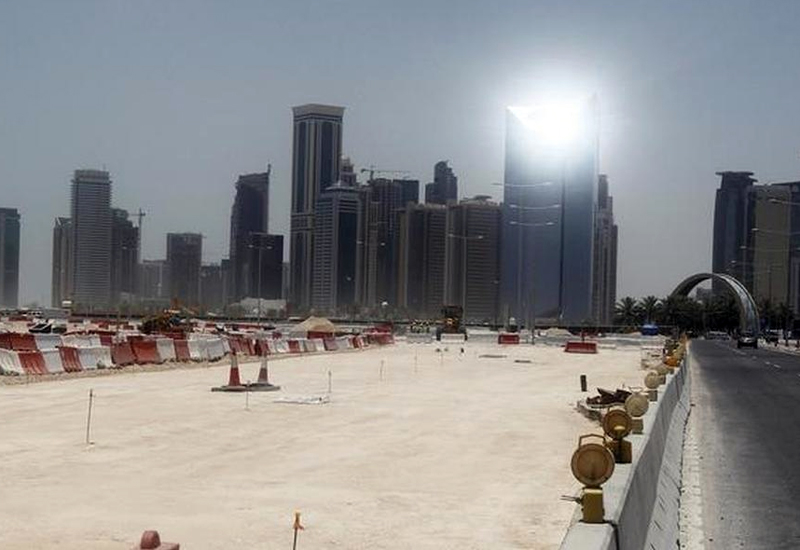 Bulldozers operate on a road under construction near Doha Towers. (Image: Mohammed Dabbous)