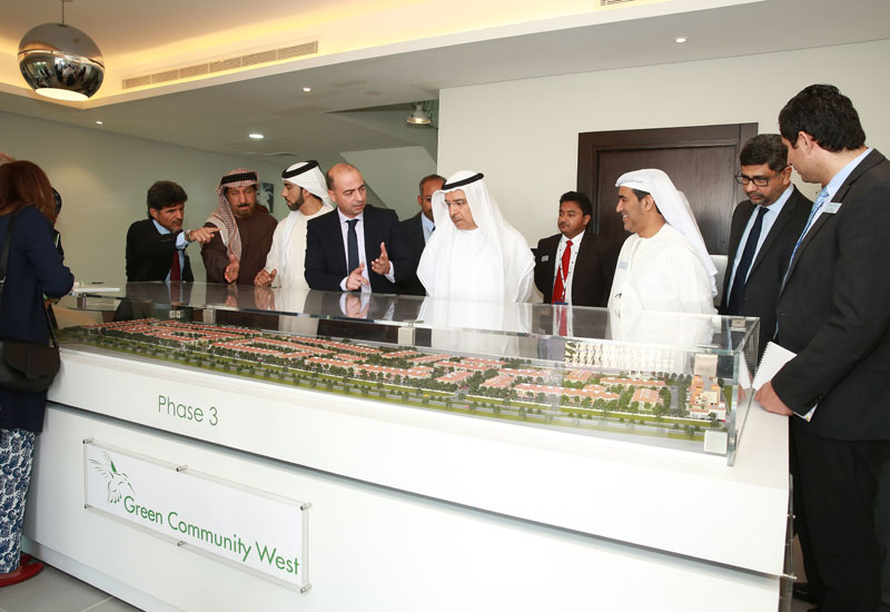 Khalid Bin Kalban and other officials viewing the model of Green Community West.