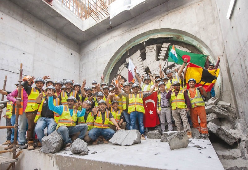The Green Line team pose in front of the TBM that signals the end of tunnelling for this section of the railway line. (Image The Peninsula)