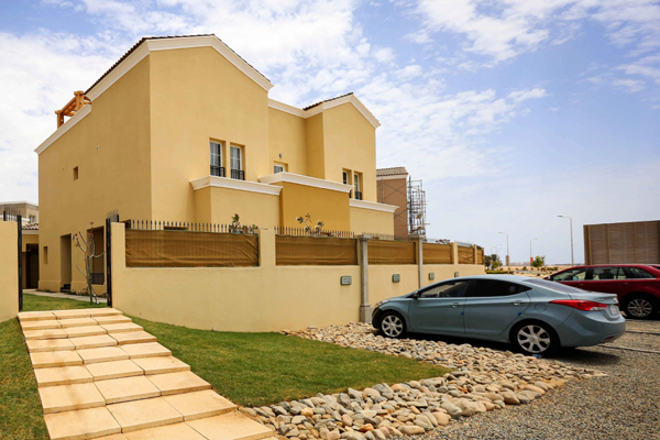 A completed residential plot with house in KAEC's Al Talah Gardens residential district.