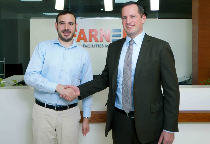 Markus Oberlin and Bader Qutteineh, business development officer ArabiaWeather Inc at the contract signing.