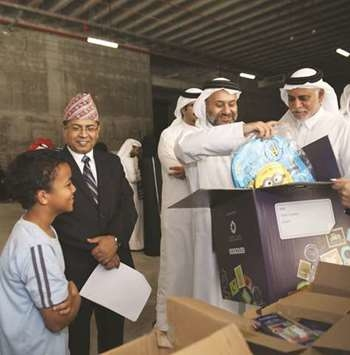 Gift boxes being packed for Nepalese construction workers in Qatar as part of a Ramadan charity initiative by Msheireb Properties.
