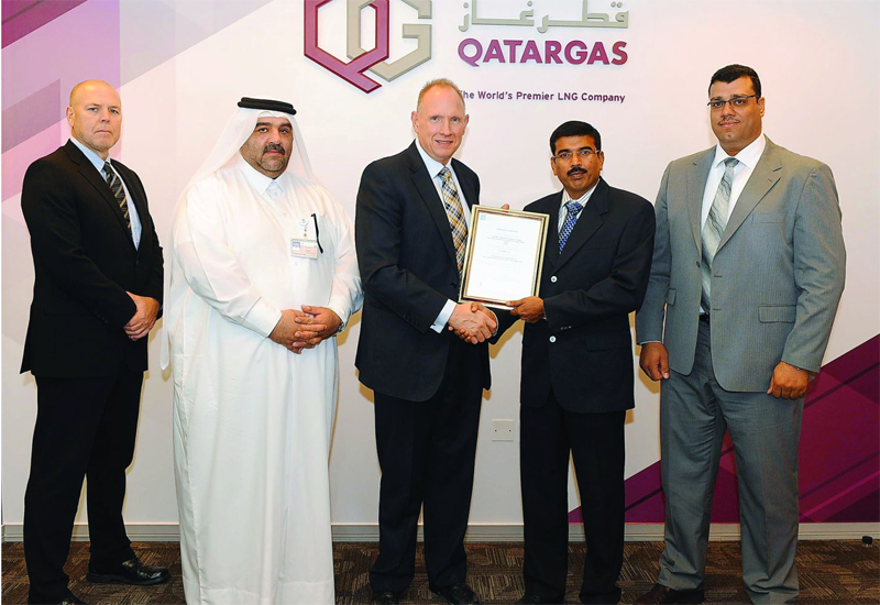 Officials at the ceremony held last week at Qatargas Doha Head Office. (image The Peninsula).