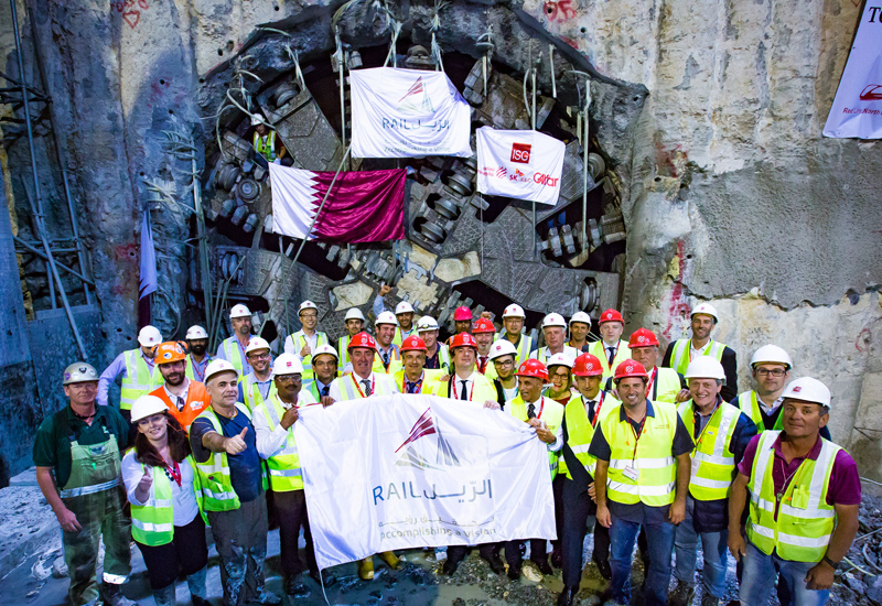 The proud Qatar Rail team stands in front of TBM 'Al Khor' after it broke through, signalling completion of tunnelling works on Doha Metro's Red Line.