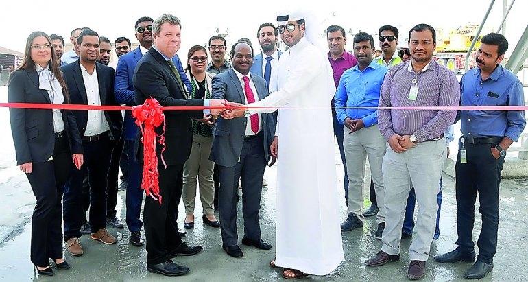 Abdullah Mohammed Al Kuwari, Sure V. Satyanarayana and Damien Healey jointly inaugurating the new ready mix plant in Ras Bufontas.