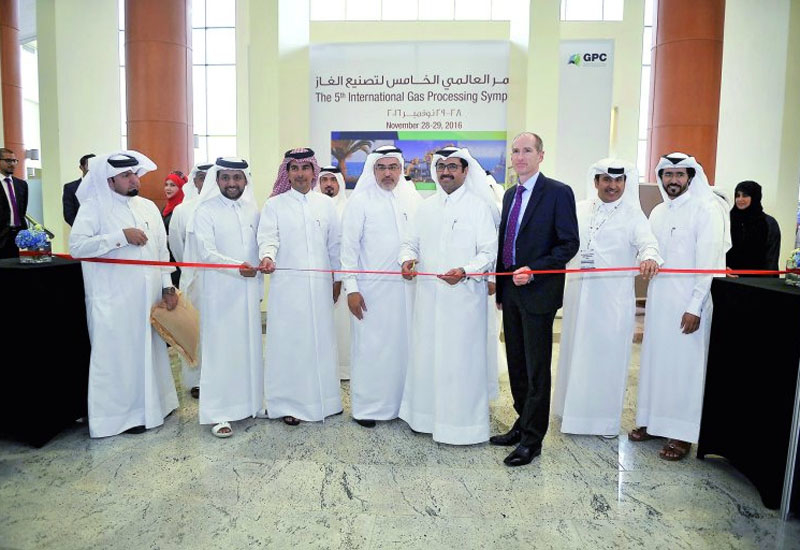 H E Dr Mohammed bin Saleh Al Sada, Minister of Energy and Industry; and other officials cutting the ribbon marking the opening of the Exhibiton of the 5th International Gas Processing Symposium, yesterday. (Image: The Peninsula.)