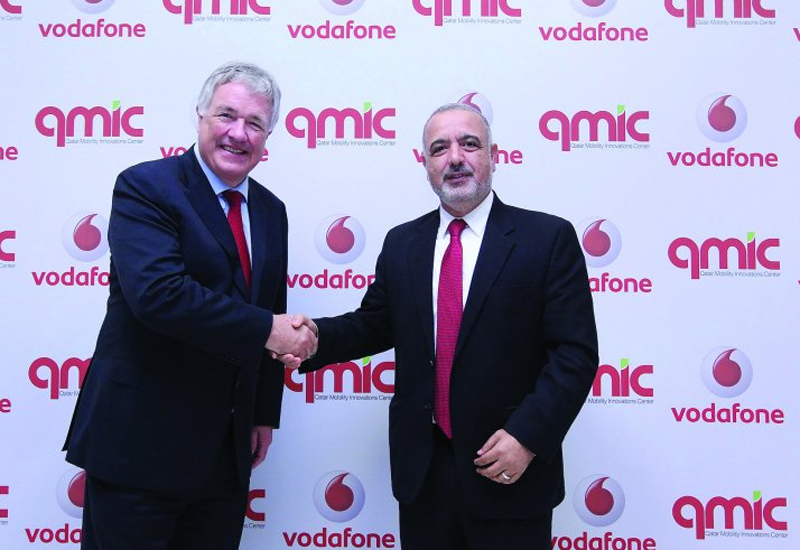 Ian Gray, CEO Vodafone Qatar (left), and Adnan Abu Dayya, CEO, QMIC at the event. (image The Peninsula)