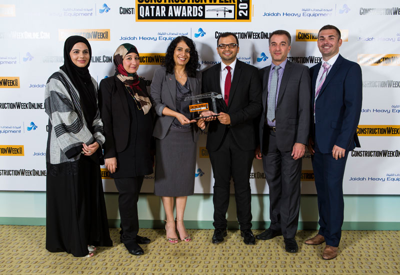 The CH2M & ictQatar team poses with the CSR Initiative of the Year award.
