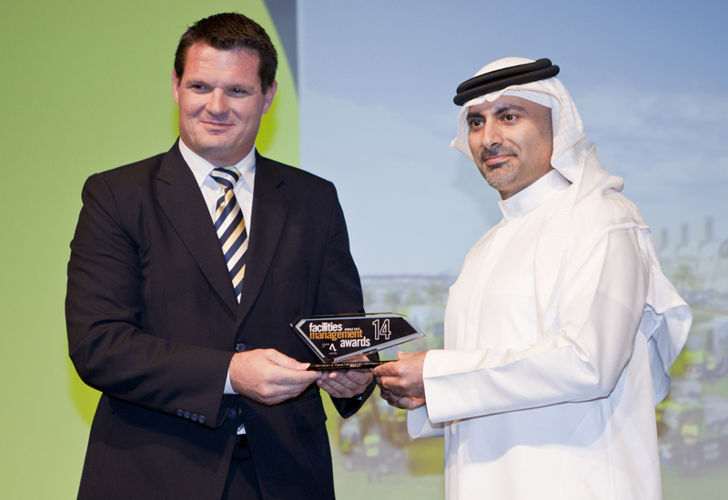 Jason Ruehland, managing director, Emrill, (left) presents the 2014 fmME Award for Sanitation & Waste Management Company of the Year to Khaled Al Hura