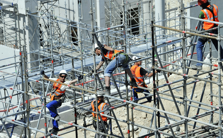 State budget cuts, low oil prices and labour reforms are impacting Saudi's construction sector.
