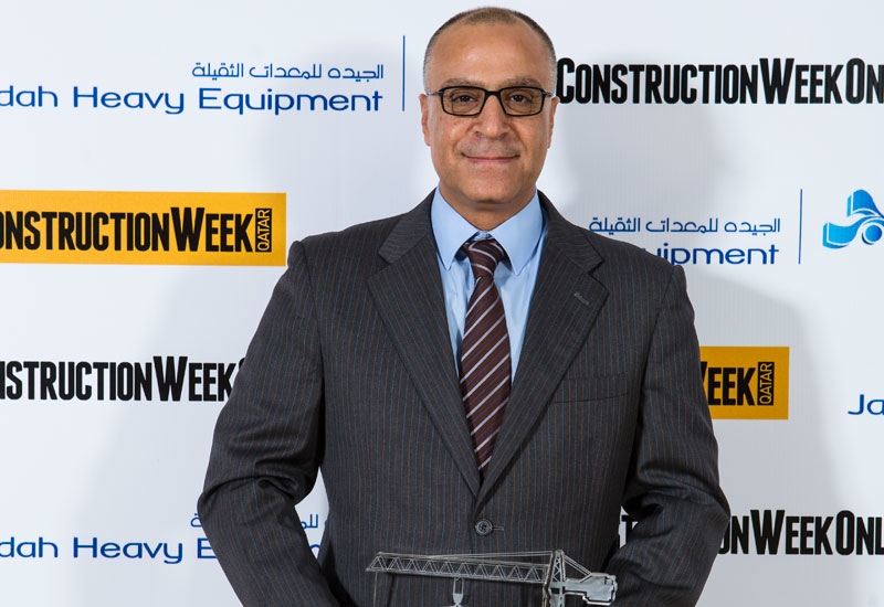 Ahmed Elwy Ali Marie, director, pre-contract services, with the winner's trophy.