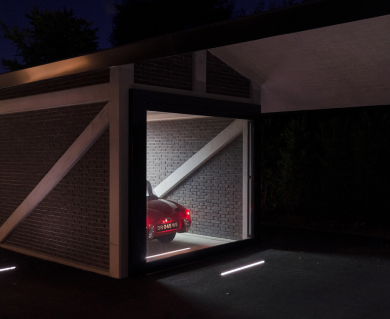 The 'James Bond' style secret garage can be controlled from a mobile phone.