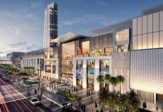Al Maryah Central's articulated mall facade, with the second phase hotel tower in the background.