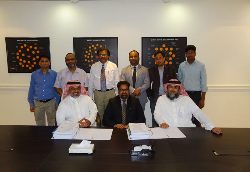 Representatives from Addar Chemicals Co and Nuberg Engineering at a signing ceremony