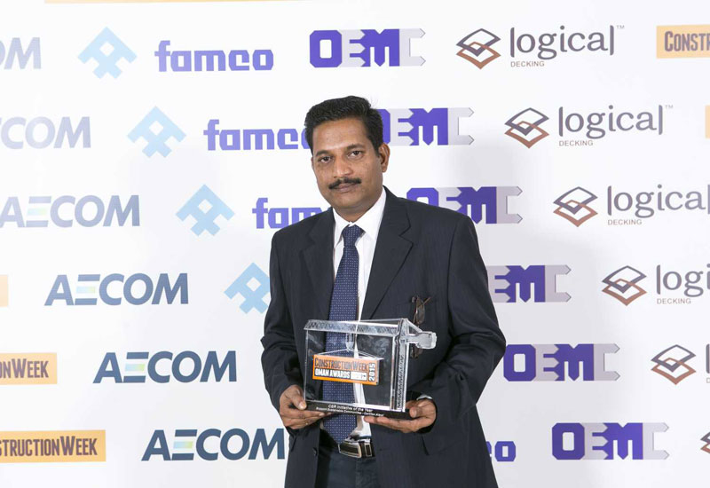 Raja Packirisamy with the Corporate Social Responsibility Initiative of the Year Trophy honouring its Supporting Sustainable Communities drive