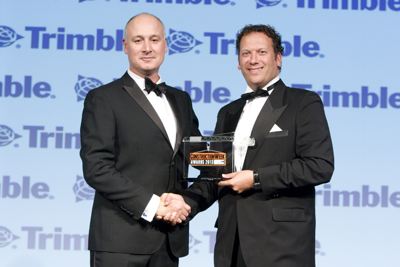 Simon Moon, chief executive officer (CEO), Atkins, Middle East, is presented with the Consultant of the Year award from Peter Hedland, Trimble