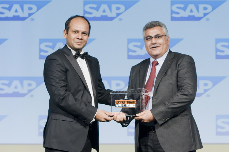 Hazem Sharaf-Eldin, vice president - UAE area manager, Road & Highway Division for Parsons receives the award from Ahmed Syed, Industry Head for Engin