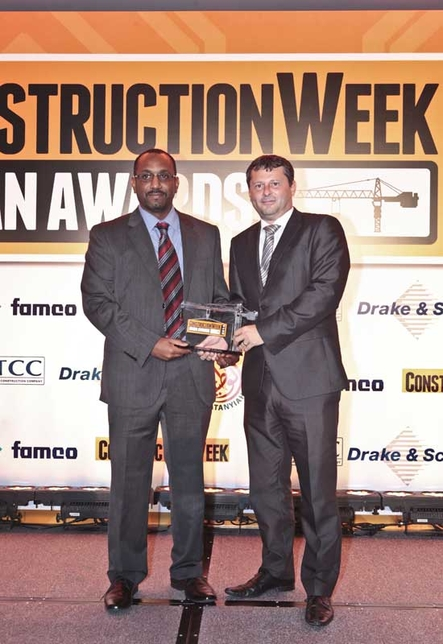 Construction Week's Group sales manager Mark Palmer presents the award to Ahmed Zeinelabdin from Atkins Global.