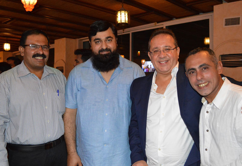 Ali Deryan, general manager, Tanzifco (second from the right), pictured here alongside staff at Tanzifco Emirates' Iftar.