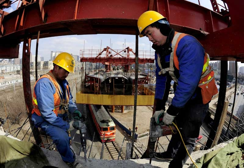 Workers on the Harbin-Dalian line built by China Railway Group (Photo: Getty Images)