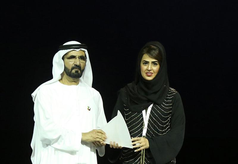 HH Sheikh Mohammed bin Rashid Al Maktoum, Vice President and Prime Minister of the UAE and Ruler of Dubai, presents Hana Al Balooshi with the Distingu