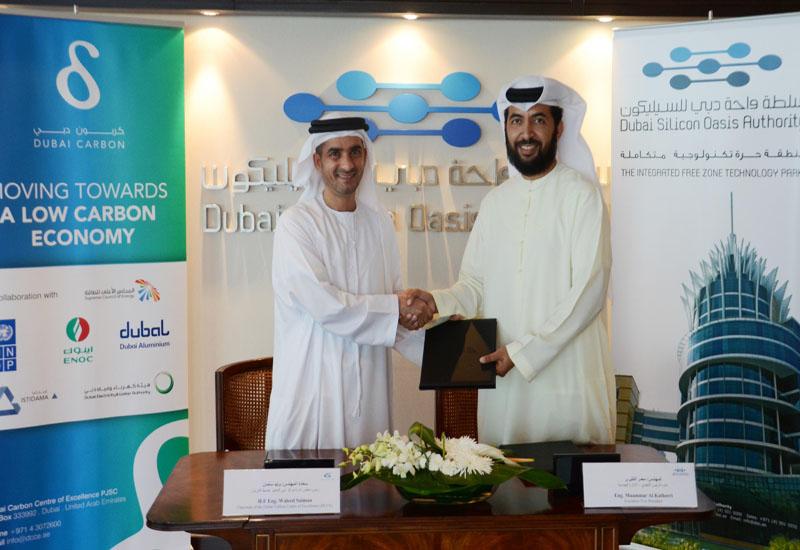 DCCE's Eng. Waleed Salman and DSOA's Eng. Muammar Al Katheeri.