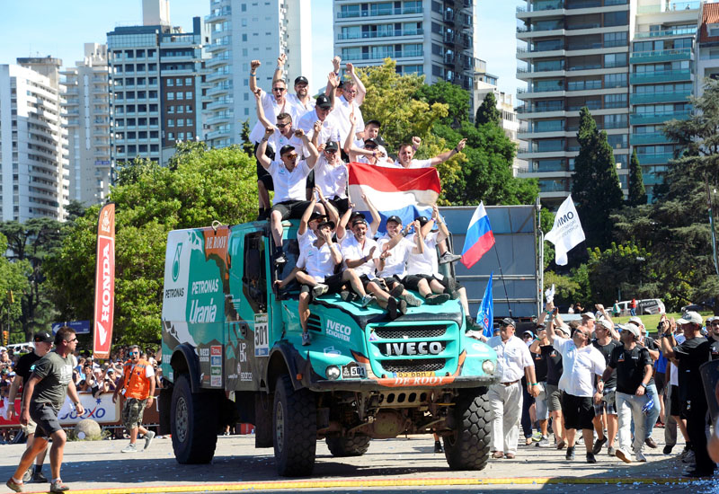 De Rooy's team celebrate and wave Italian flags fromon top of their triumphant Iveco Powerstar.