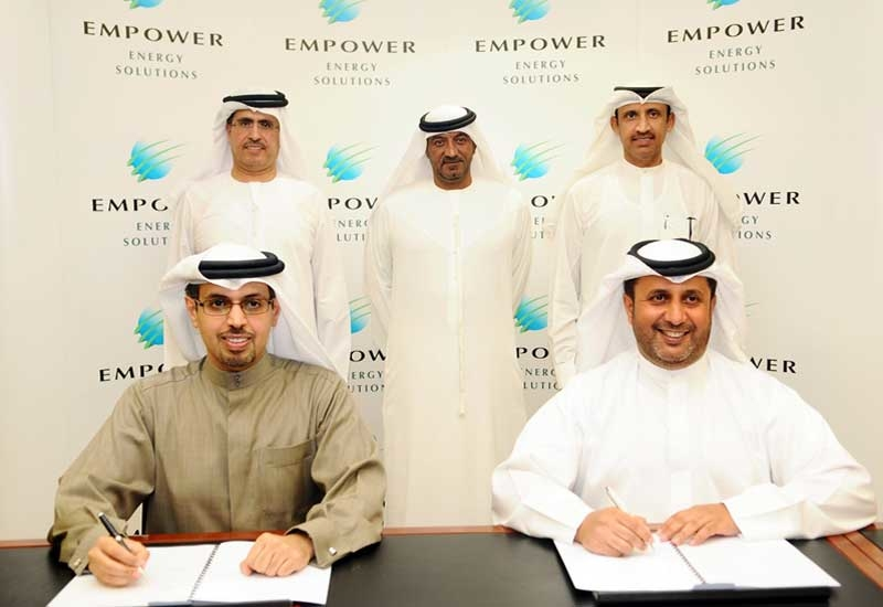 Eng Hamad Buamim (front left) of Dubai World signs the merger agreement with Empower CEO HE Ahmad Bin Shafar (front right)