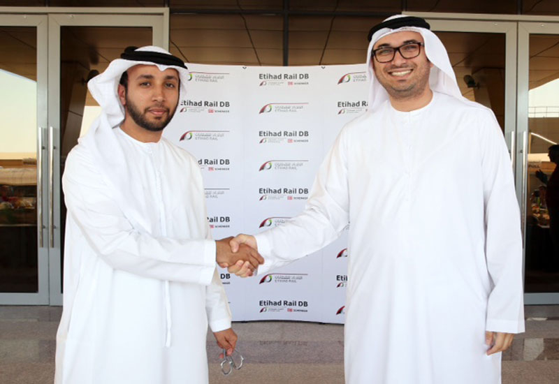 Shadi Malik of Etihad Rail DB and Etihad Rail CEO Faris Saif Al Mazrouei at the handover