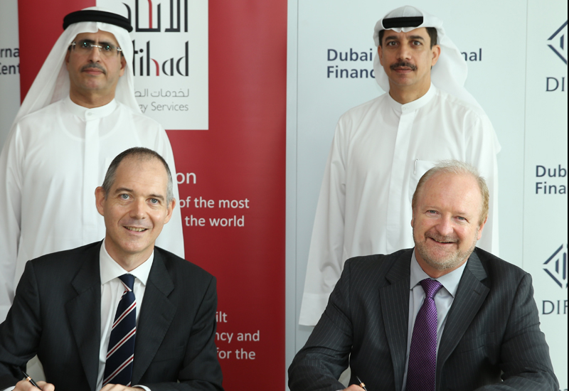 Officials from Etihad ESCO and DIFC at the signing of the agreement.