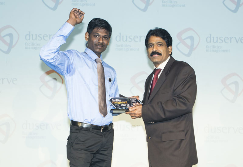 In picture: Nasser Kajoor Al Nuami, CEO, Duserve (right) presents the Unsung Hero of the Year trophy to Jothieswaran from Emrill.