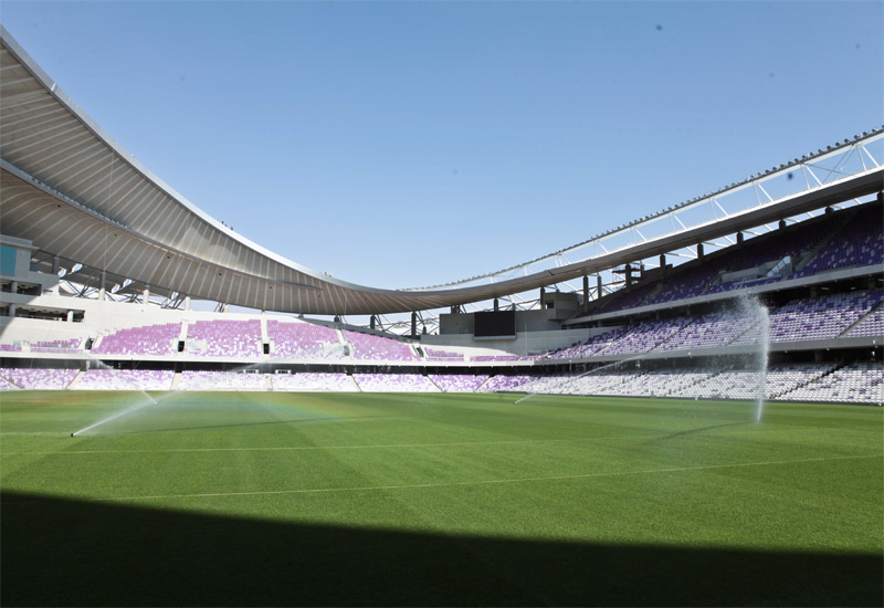 The sprinkler system comes into action at the Hazza Bin Zayed Stadium.
