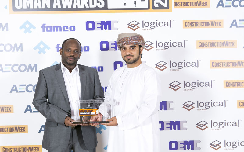Omran's MEP manager Abdullah Ahmed (left) and architectural engineer Muyasser Ali Al Kumzari (right) with the Hospitality of the Year trophy