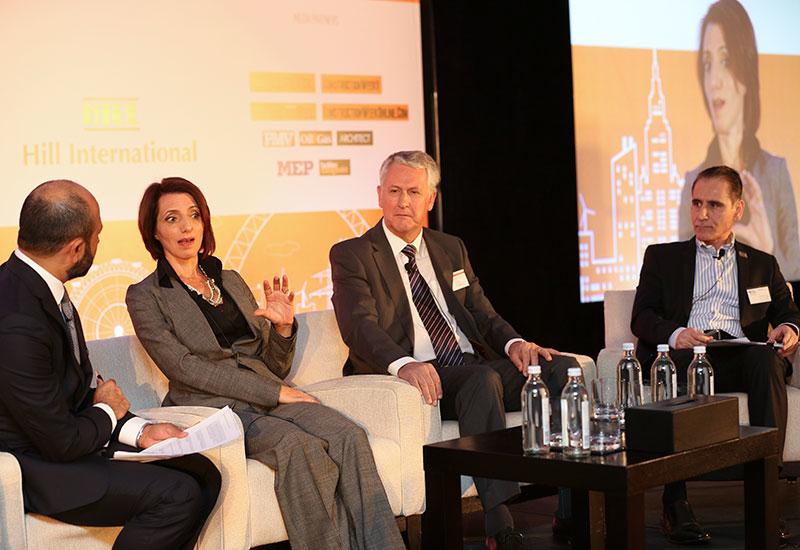 Panel moderator Sachin Kerur (left) with [from left] Sumaya Dabbagh, Stephen Flint and Issam Ezzeddine.