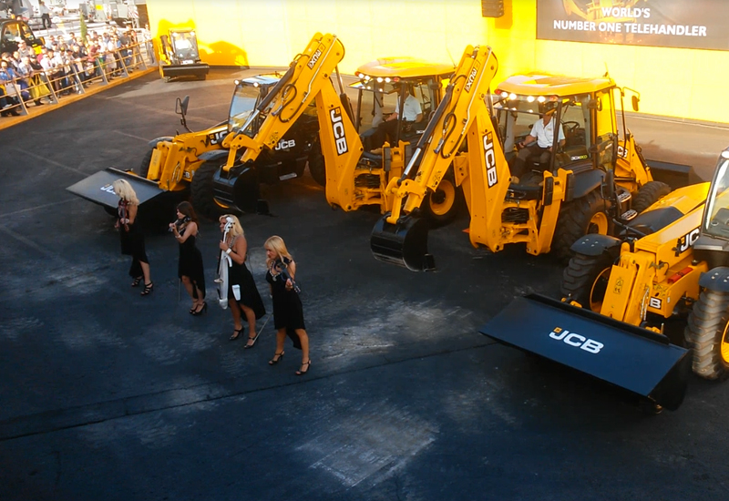 Six JCB machines joined forces with a string quartet to dance daily in front of the Las Vegas crowd.