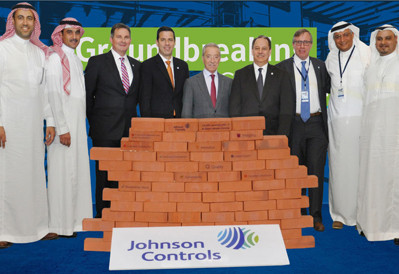 The management team from Al Salem Johnson Controls with representatives from King Abdullah Economic City