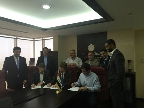 Hertz and Khudairi executives at the signing for the deal.